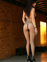 Autumn shows she has nothing to hide in her full body black fishnets!
