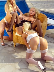 Three lesbians teasing in sexy lingerie outdoors