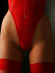 Bree will have you seeing RED in her red fishnet thigh highs and red lace thong one piece